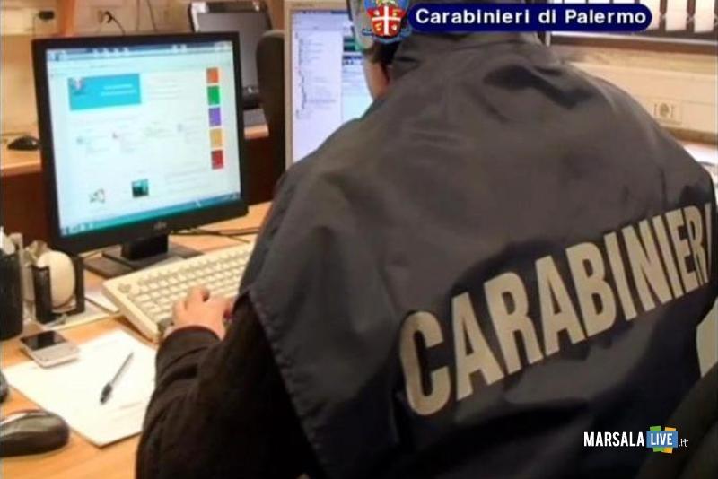 Foto generica carabinieri di Palermo, militare di spalle davanti a computer